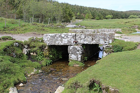 Stone clapper bridge over a stream Bodmin Moor Cornwall
